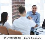 young entrepreneurs shaking... | Shutterstock . vector #1171561120