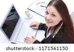 .female assistant sitting at... | Shutterstock . vector #1171561150