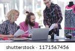 team of designers discussing... | Shutterstock . vector #1171567456