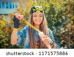 modern young woman in denim and ... | Shutterstock . vector #1171575886