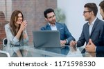 business team holds a business... | Shutterstock . vector #1171598530
