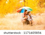 a little boy and his father are ...   Shutterstock . vector #1171605856