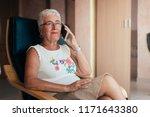 elderly woman on the mobile... | Shutterstock . vector #1171643380