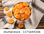 bowl with dried apricots on... | Shutterstock . vector #1171644106