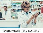 portrait smiling pharmacist...   Shutterstock . vector #1171650319