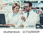 female and male pharmacist... | Shutterstock . vector #1171650439