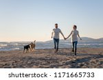 couple running on the beach... | Shutterstock . vector #1171665733