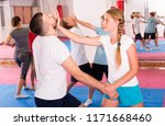 kids with adults practicing... | Shutterstock . vector #1171668460