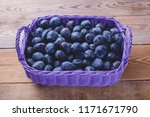 basket full of delicious plums  ... | Shutterstock . vector #1171671790