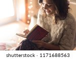 young woman writing on a... | Shutterstock . vector #1171688563