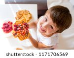 sweet birthday boy  eating... | Shutterstock . vector #1171706569