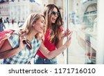 women in shopping. two happy... | Shutterstock . vector #1171716010