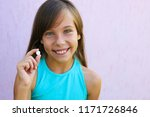 happy girl holding a pill in... | Shutterstock . vector #1171726846