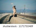 single woman relaxing in... | Shutterstock . vector #1171732489