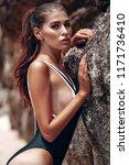 young beautiful girl in black... | Shutterstock . vector #1171736410