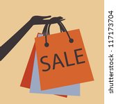 A Hand Holding Shopping Bags T...