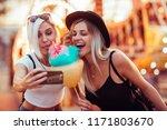 happy female friends in... | Shutterstock . vector #1171803670