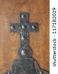 Metal Cross On A Wooden Door