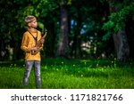 in an outdoor park  a young boy ...