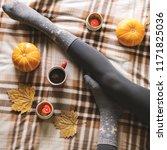 women's feet in woolen cozy... | Shutterstock . vector #1171825036