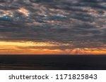 picturesque sunset over... | Shutterstock . vector #1171825843