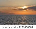 glowing golden sun  cloudy sky... | Shutterstock . vector #1171830589