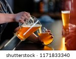 bartender pouring beer from a... | Shutterstock . vector #1171833340