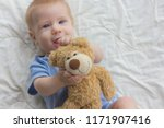 the baby with keeps a teddy... | Shutterstock . vector #1171907416