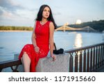 a girl in a long red dress is... | Shutterstock . vector #1171915660