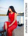 a girl in a long red dress is... | Shutterstock . vector #1171915663