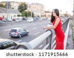 girl in a long red dress is... | Shutterstock . vector #1171915666