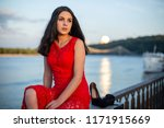 a girl in a long red dress is... | Shutterstock . vector #1171915669