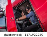 Happy Caucasian Semi Truck Driver Showing Thumb Up. Trucking Theme. Transport Industry. - stock photo
