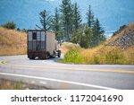 a powerful big rig semi truck... | Shutterstock . vector #1172041690