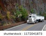big rig white classic american...   Shutterstock . vector #1172041873