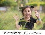 cheerful asian children kidding ... | Shutterstock . vector #1172069389