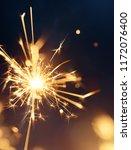 burning sparklers  happy new...   Shutterstock . vector #1172076400