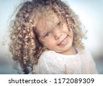 outdoor portrait of a smiling... | Shutterstock . vector #1172089309