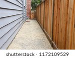 long narrow side yard  new wood ... | Shutterstock . vector #1172109529