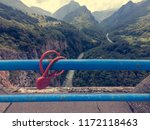red lovelock chained to a metal ... | Shutterstock . vector #1172118463