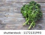 fresh green curly kale leaves... | Shutterstock . vector #1172131993