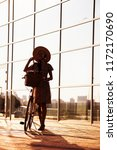 cute girl in hat is traveling... | Shutterstock . vector #1172170690