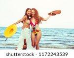 happy women in bikinis dance... | Shutterstock . vector #1172243539