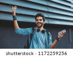 young handsome man using... | Shutterstock . vector #1172259256