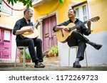 Two Fado Guitarists With...