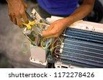 technician repairing outdoor... | Shutterstock . vector #1172278426