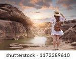 woman tourist is enjoy... | Shutterstock . vector #1172289610