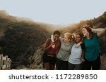 Diverse Friends Hiking Through...