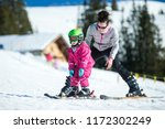 Mother And Little Child Skiing...