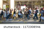 motion blurred anonymous crowds ... | Shutterstock . vector #1172308546